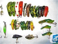 A table full of new and used fishing lures. 99% are in