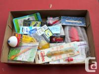 For sale is a fishing tackle box with contents and a