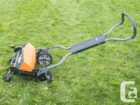 Fiskars 6201 Push Reel Mower for mowing your lawn. This