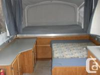 camping trailer sleeps 5 (maybe 6), 3 beds ( queen,