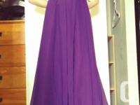 In excellent condition like new. Size 7/8, strapless,