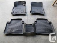 Like new set of Husky Liner floor mats and OEM Honda