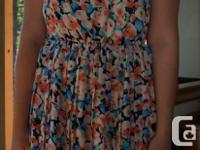 Hello Miss floral summer dress. Pleated skirt, higher