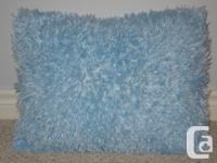 Super soft, fluffy blue decorative pillow - great for a