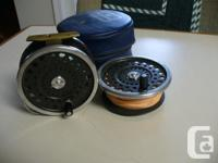 FLY REEL IS USED BUT IN GOOD CONDITION. X/W SPARE SPOOL
