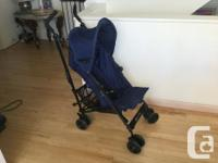 Exellent condition foldable, navy blue stroller from a
