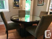 Offering a round dining room table + set of 6
