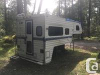 Large truck camper. In decent shape needs some elbow
