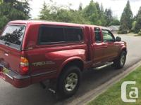 Make Toyota Model Tacoma Year 2002 Colour red kms