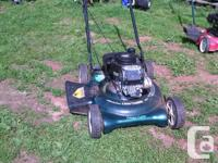 The lawnmower repairman has another push mower for