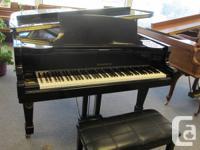 "6'10"" polished black Samick grand piano with matching"