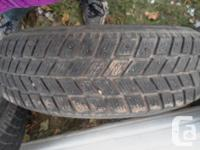 4 Studded winter tires on Ford aluminum rims. Very good