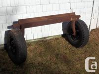 This is a set of wheels attached to a piece of I beam