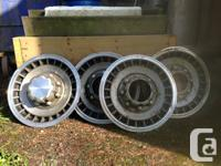 Older Ford Truck F Series hub caps for sale off of a