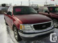 Make. Ford. Design. F-150. Year. 2000. Colour. red.