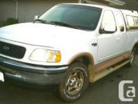 Make. Ford. Design. F-150. Year. 1997. Colour. white.
