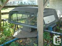 This is a Glasstite hi-rise full size 8' truck canopy.