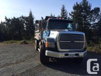 Ford L9000 dump truck. 425 hp cat, 8 speed