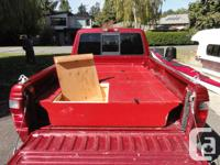 Three solid cargo boxes that fit flat into the bed of a
