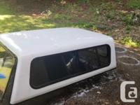 White Ford shortbox canopy comes with aluminum clamps.