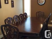Beautiful 11 piece formal Dining Room set. Table comes