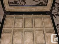 Selling a new condition watch box by Fossil. Its black