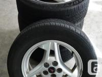 Set of four 15-inch alloy wheels for 2005 Pontiac
