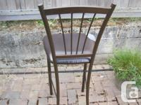 Four bar stools. Upholstery worned out. 47 inches high,