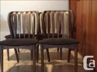 Four chairs with unusual curved wood construction and