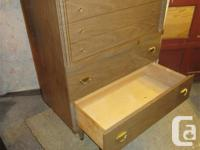 THIS CHEST HAS FOUR DOVETAILED DRAWERS. THEY MOVE