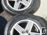 """Four Jeep 5 stud 17"""" alloy rims from a 2009 Jeep"""