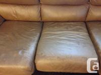 7 foot long brown leather couch with black and silver