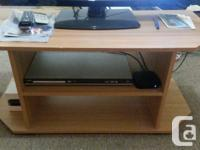 Free TV stand! In wonderful disorder. Rounded edges so
