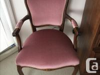 The French Provincial settee has walnut wood trim. It