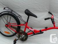 NEW Trail-a-bike accessory,. Consists of back shelf,.