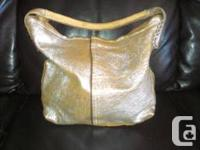 I am offering this brand-new Antiquarian Purse like the