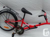 NEW Trail-a-bike attachment,. Includes back shelf,.