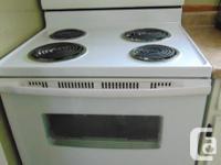 Amana Fridge and stove 2 1/2 years old . Fridge(18cu