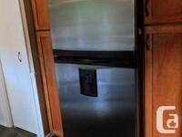 Maytag made for Kenmore.  Fridge has ice maker and
