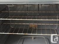 "Frigidaire White stove 30"" wide with self-cleaning"