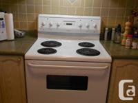 Frigidaire Electric Cooking Range with hood for