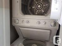 Well-taken care of stacked washer/dryer combo. Was