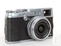 Excellent Condition pocket camera with 23mm f2.0 lens.