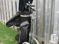 Set of Ram Accubar golf clubs plus bag and cart. In