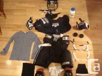 Full Set of Hockey Equipment for a Youth with handle