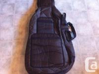 Brown, nylon full size (4/4) cello case with bow holder