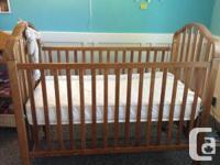 I have a lighter walnut shade oak crib with a mattress