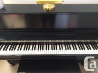 This very well-maintained 1980 Lesage Upright Piano was