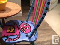 Handpainted colourful chairs by local artist. Great for