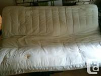 Older metal futon couch and matters and green over